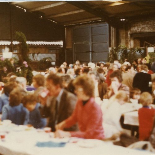 Celebrating the Silver Jubilee with a feast in a village barn.